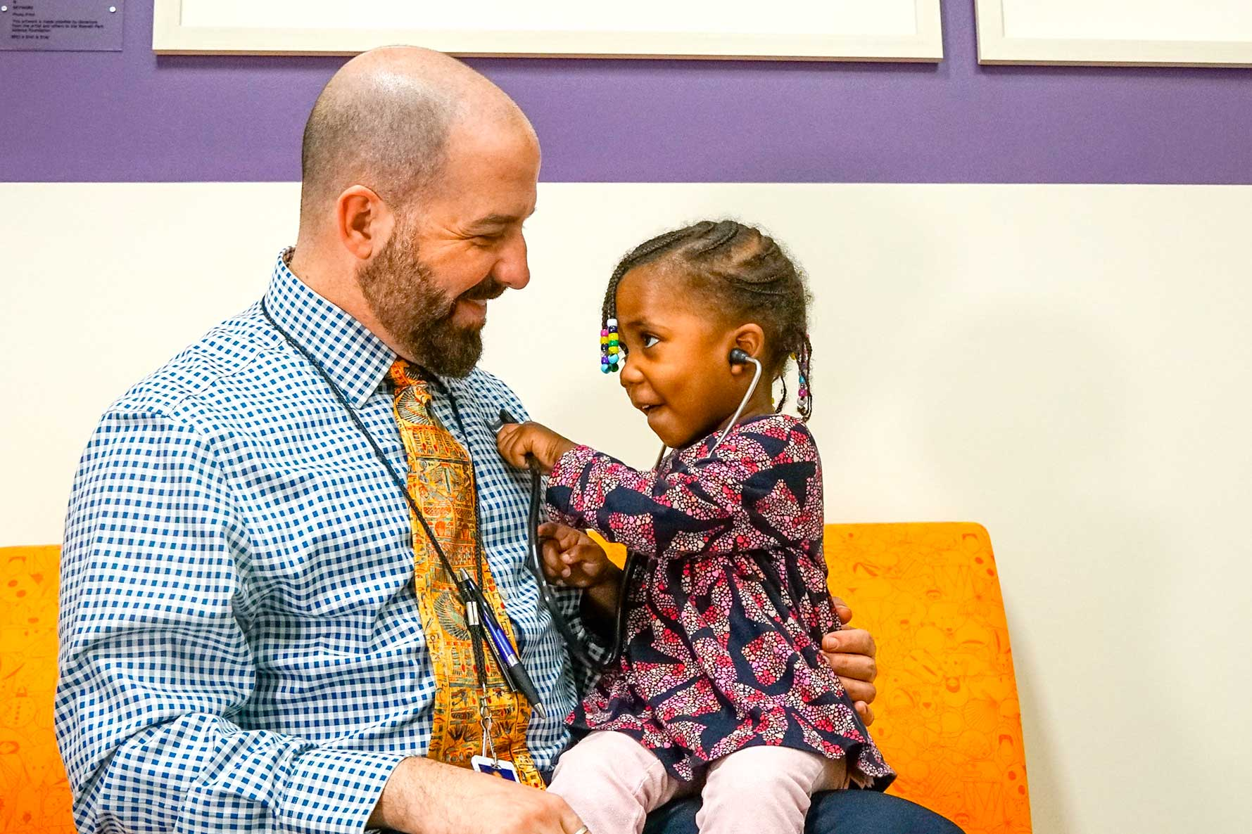 Steve Ambrusko, MD with pediatric patient.