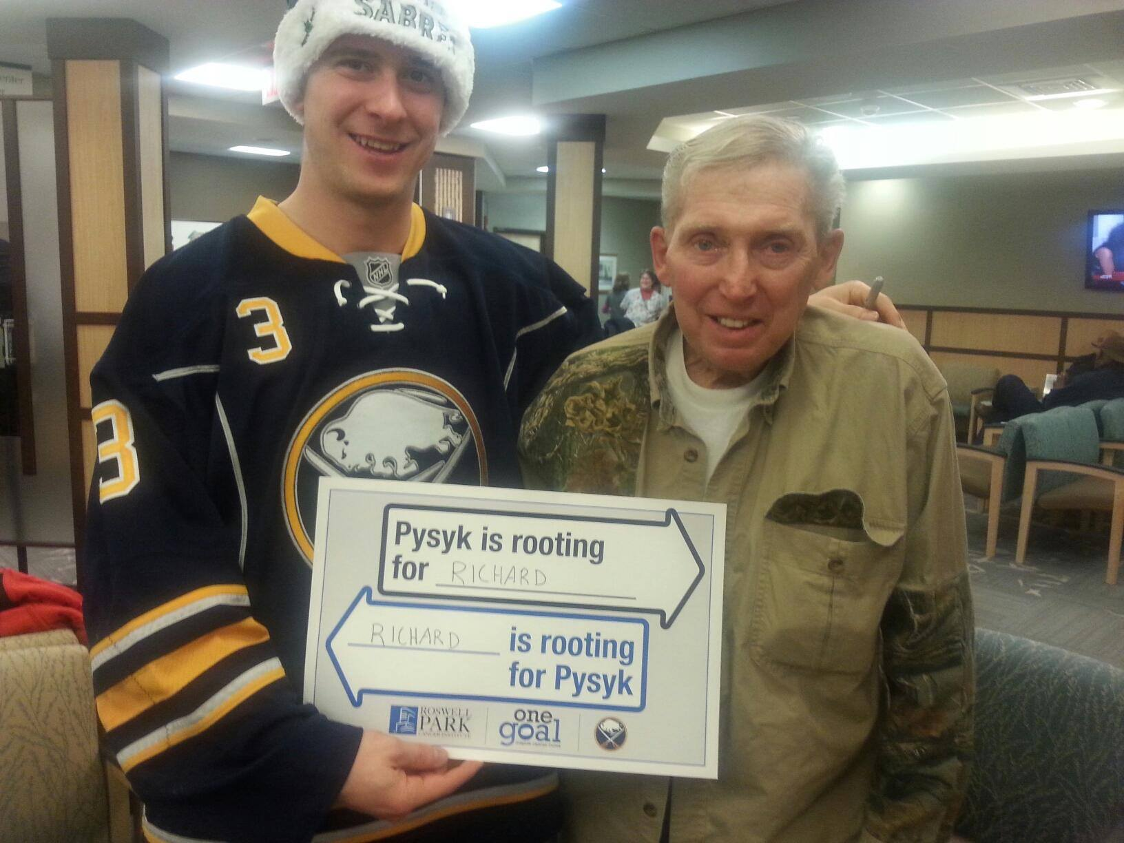 Sabres defenseman Mark Pysyk visits with a patient during a visit to RPCI on December 16, 2015.