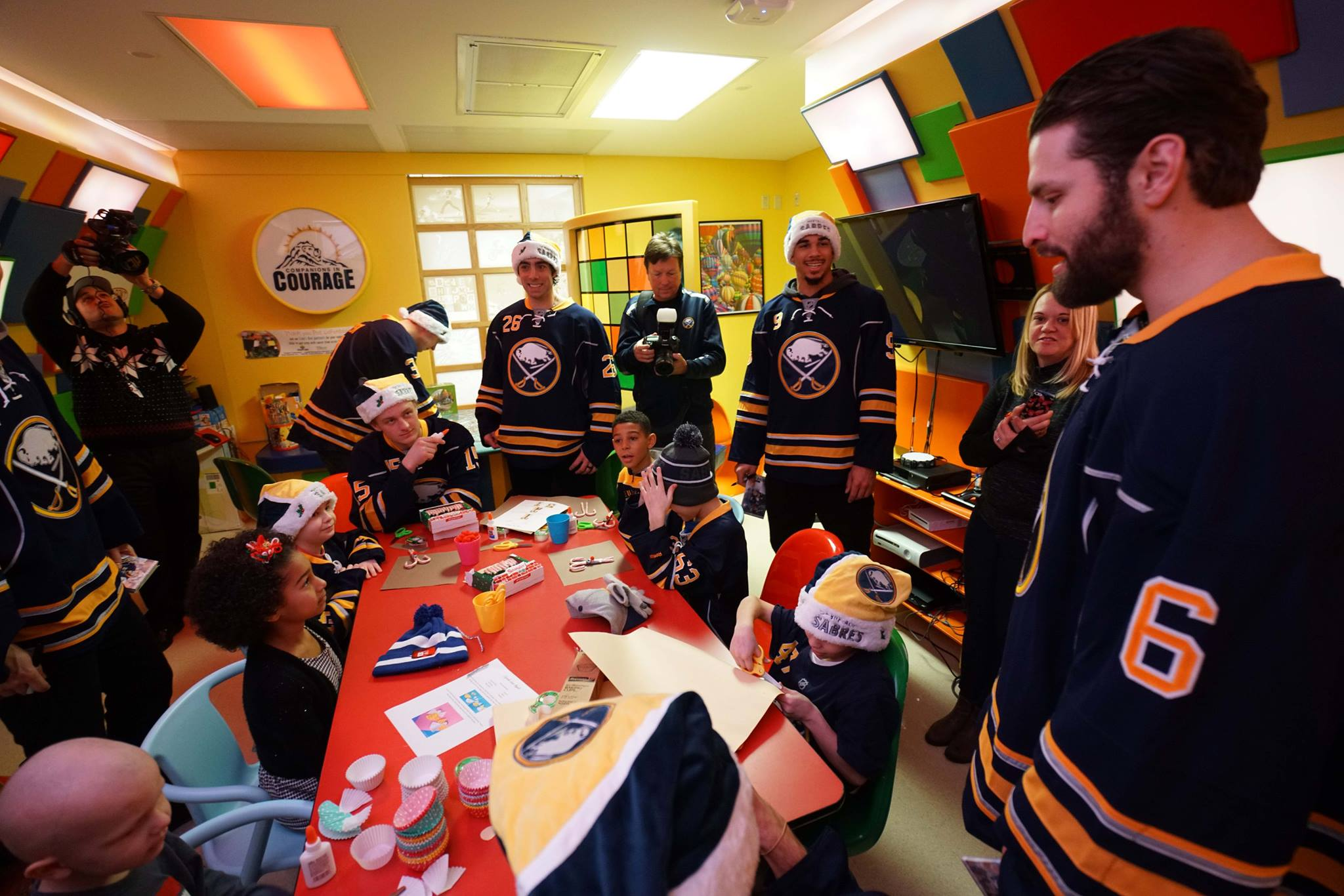 Members of the Sabres, including Matt Moulson, Evander Kane and Mike Weber visit with young patients in the Lion's Den during a visit to RPCI on December 16, 2015.