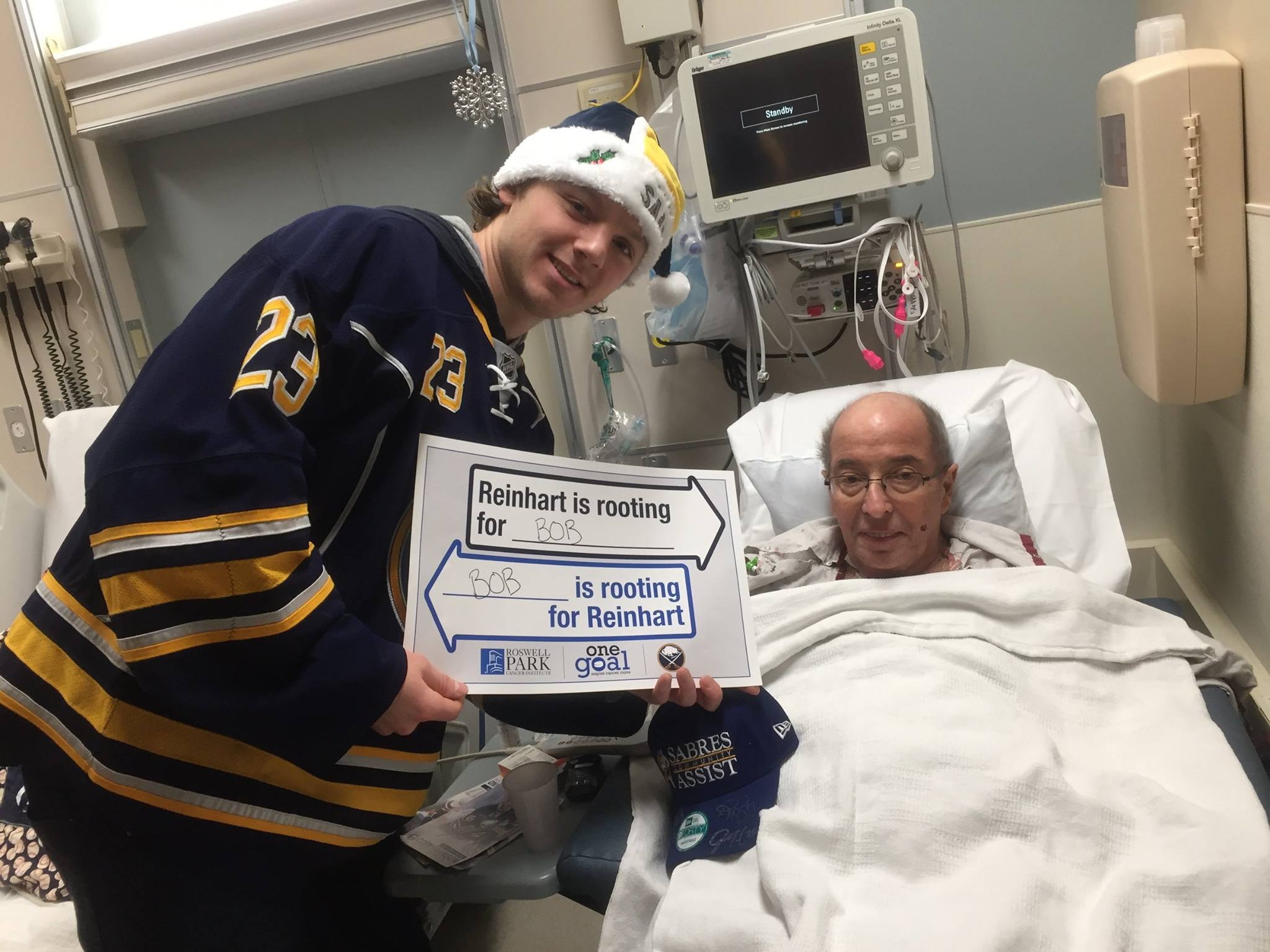 Sabres forward Sam Reinhart visits with a patient during a visit to RPCI on December 16, 2015.