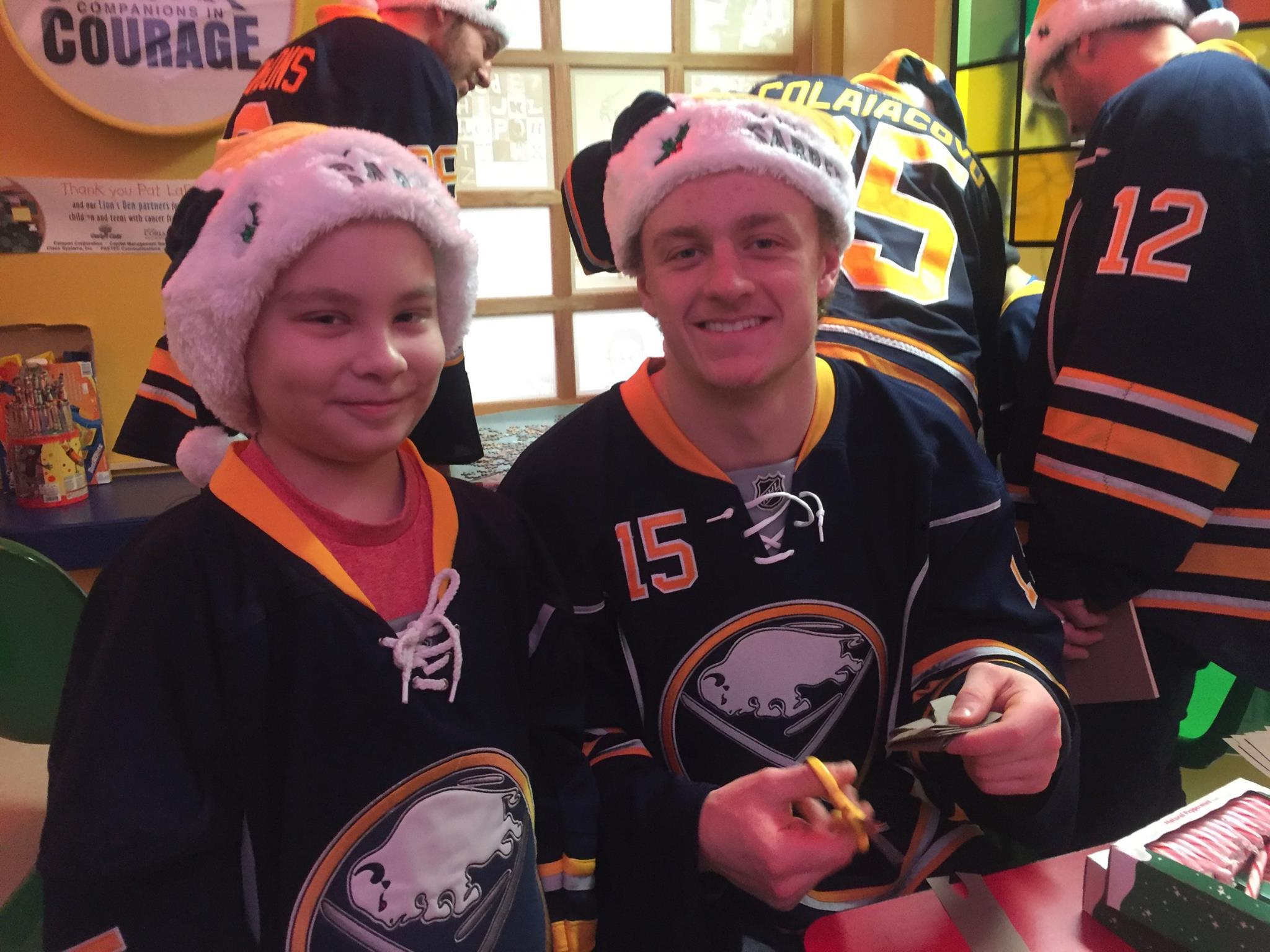 Jack Eichel and a young patient have fun with crafts in the Lion's Den during a visit to RPCI on December 16, 2015.
