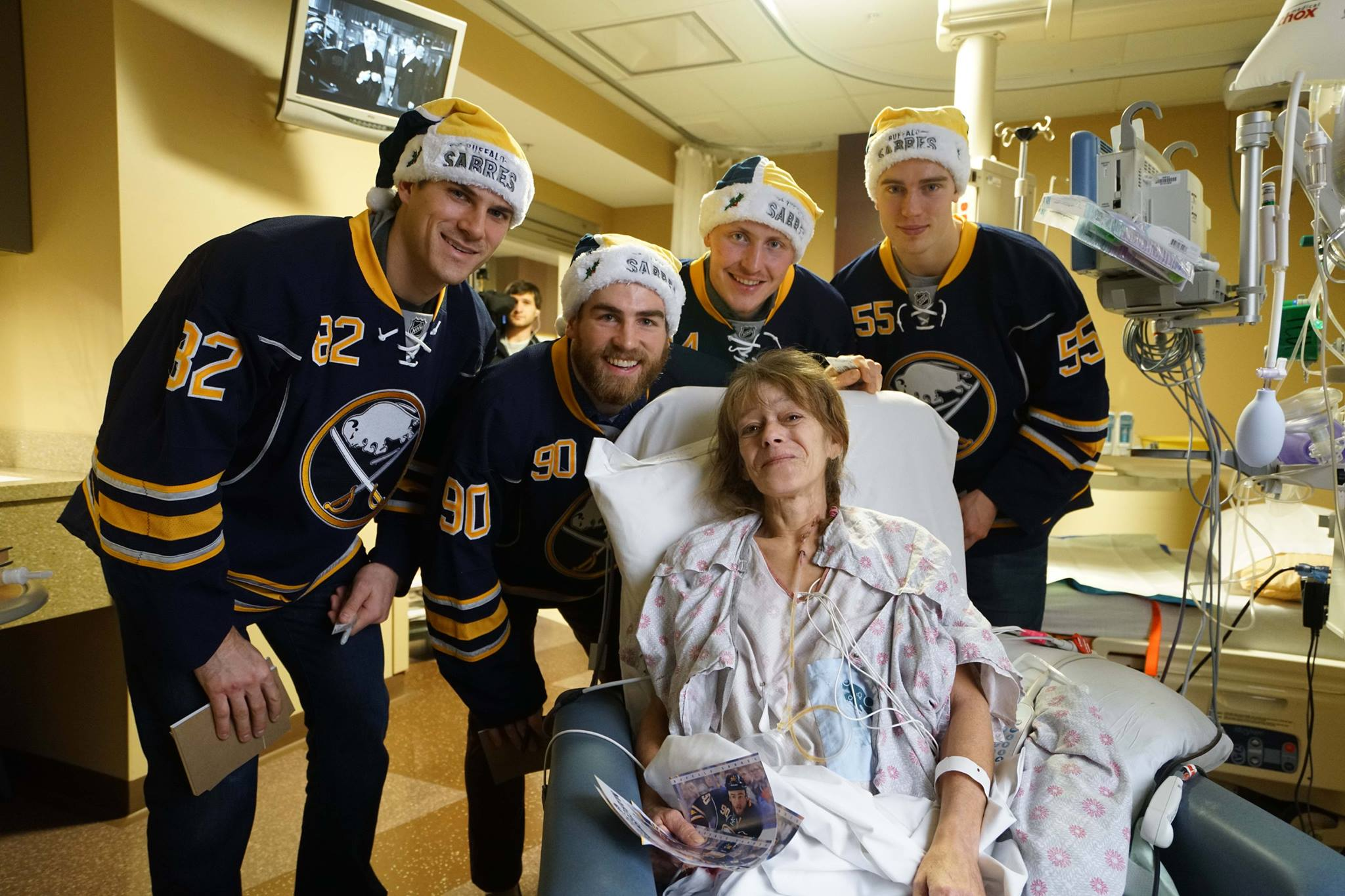 Marcus Foligno, Ryan O'Reilly, Nicolas Deslauriers and Rasmus Ristolainen meet with a patient during a visit to RPCI on December 16, 2015.