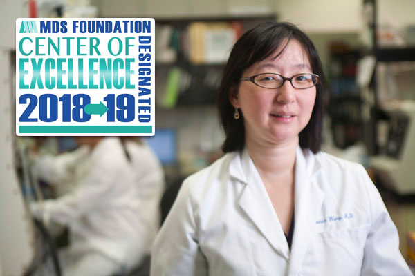 Eunice Wang in lab with MDS logo overlayed on image