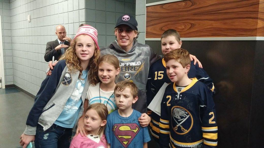 Tyler Ennis visits with young fans at the Hockey Fights Cancer game on October 24, 2015.