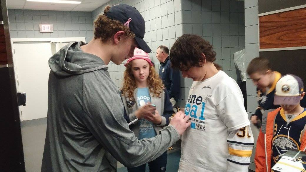 Jack Eichel signs autographs at the Hockey Fights Cancer game on October 24, 2015.