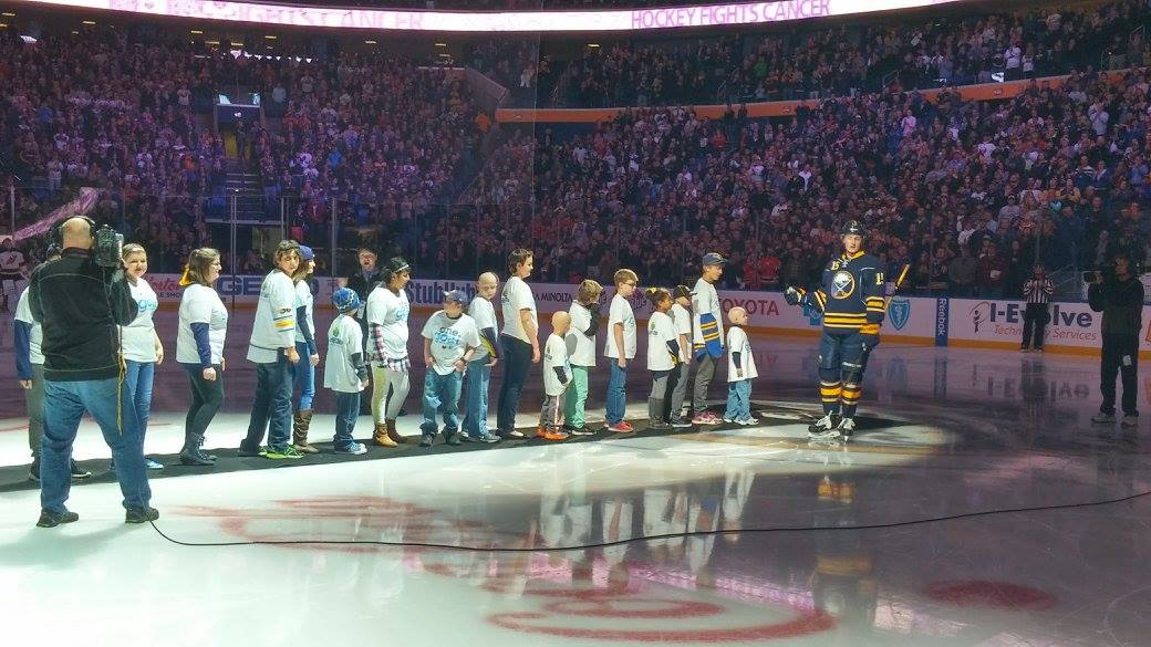 Sabres forward Jack Eichel welcomes 18 members of Carly's Club on the ice prior to the Hockey Fights Cancer game on October 24, 2015.