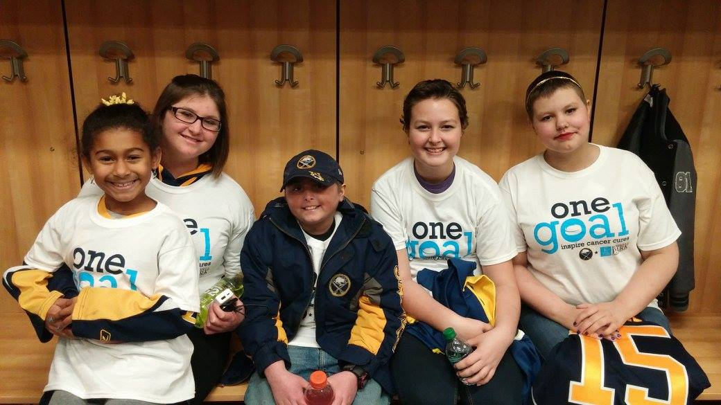 Members of Carly's Club visit the Sabres' locker room prior to the Hockey Fights Cancer game on October 24, 2015.