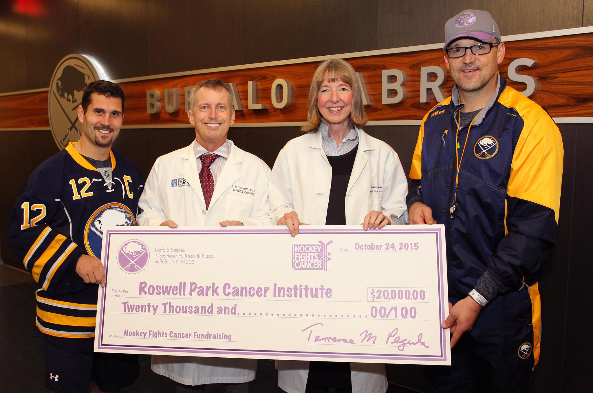 Brian Gionta and Dan Bylsma present the Hockey Fights Cancer donation to Drs. Kuvshinoff and Johnson