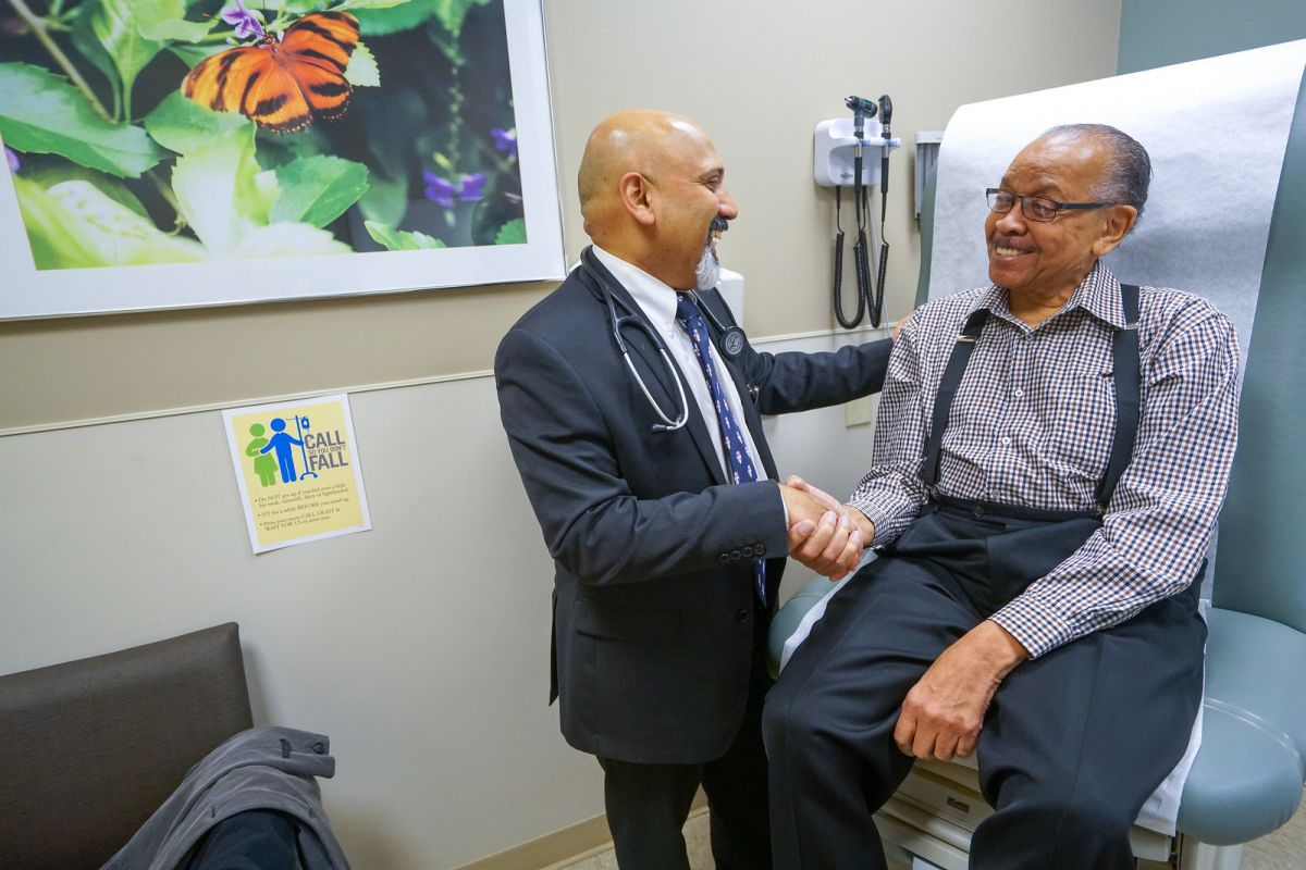 Dr. Saby George treats a patient with prostate cancer