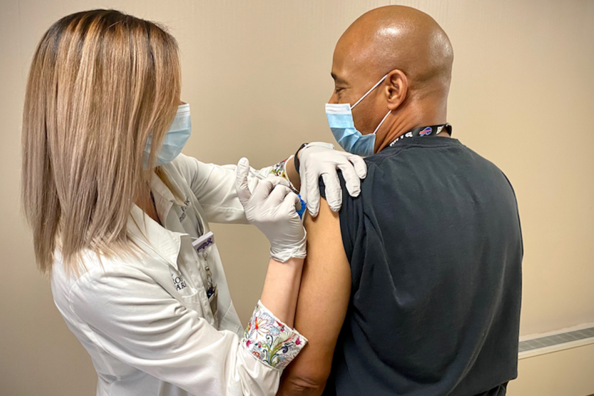 Roswell Park phlebotomist Dwayne Smith gets his COVID vaccination