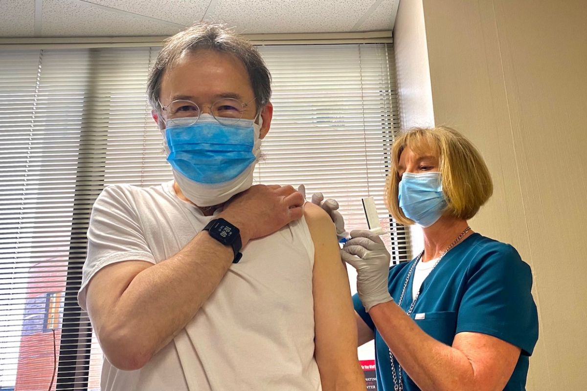 Dr. Phillip McCarthy receives his COVID-19 vaccine.