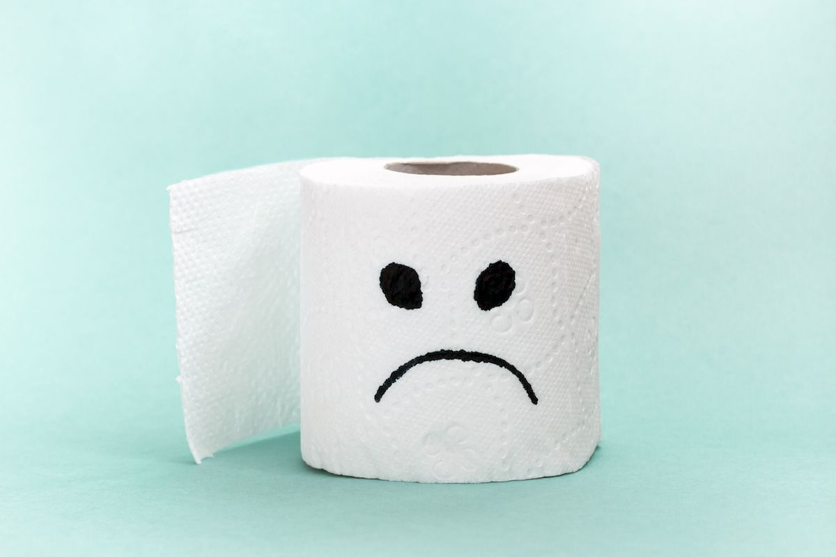 photo of a roll of toilet paper with an unhappy face