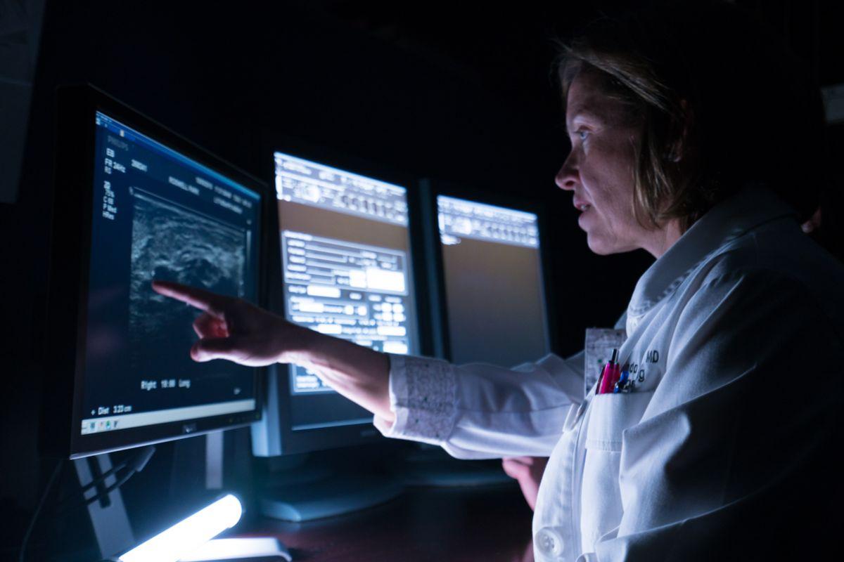 Dr. Ermelinda Bonaccio, Director of Mammography, reviews a mammogram scan.