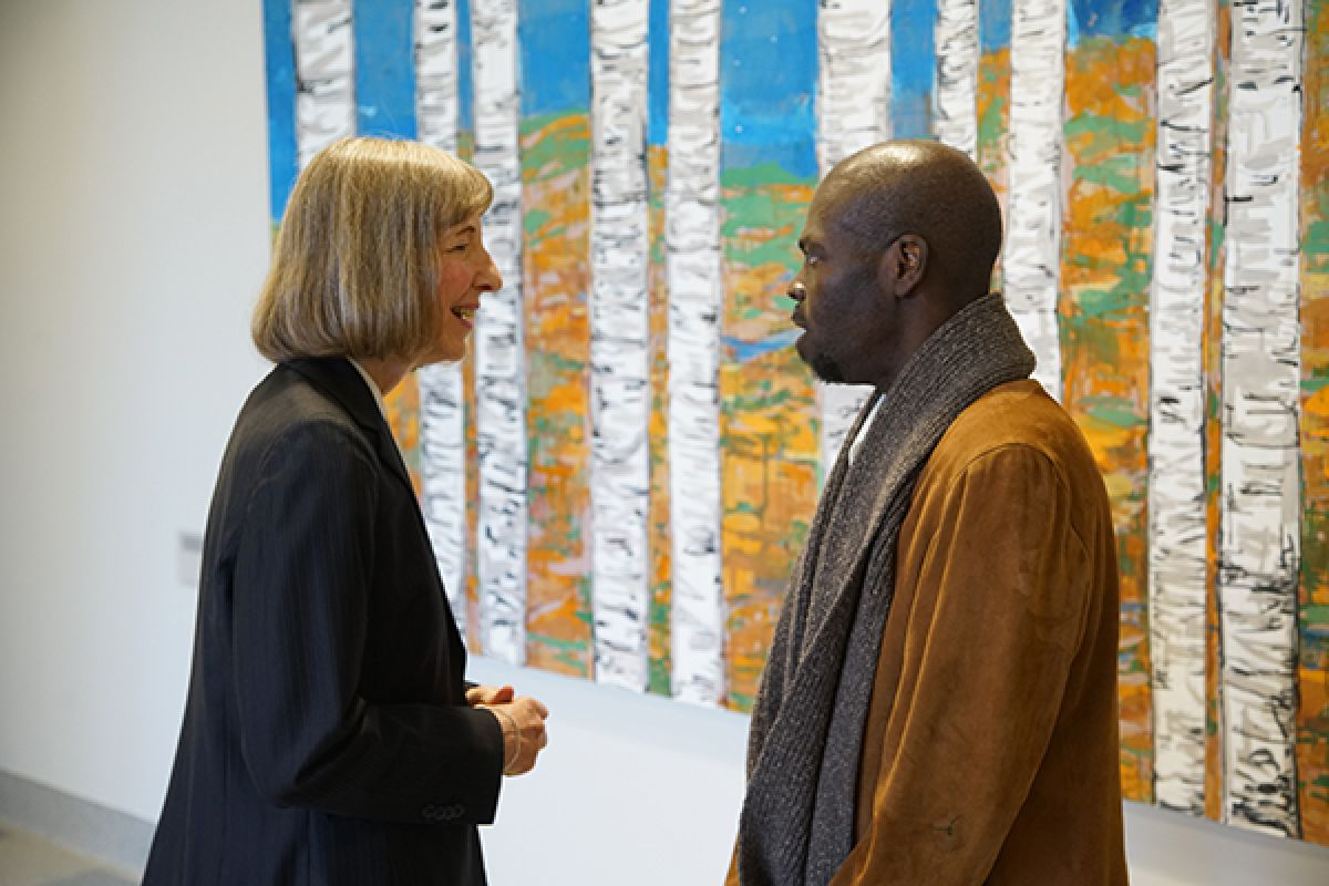 Buffalo artist Rodney Taylor with Roswell Park President & CEO Candace Johnson, PhD.