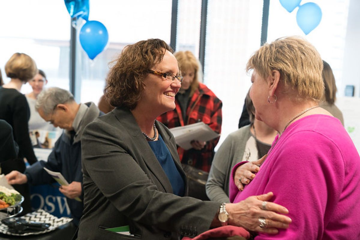Mary Reid, MSPH, PhD, Director of Cancer Screening and Survivorship (left), greets a visitor at the grand opening of Roswell Park's Survivorship and Supportive Care Center.