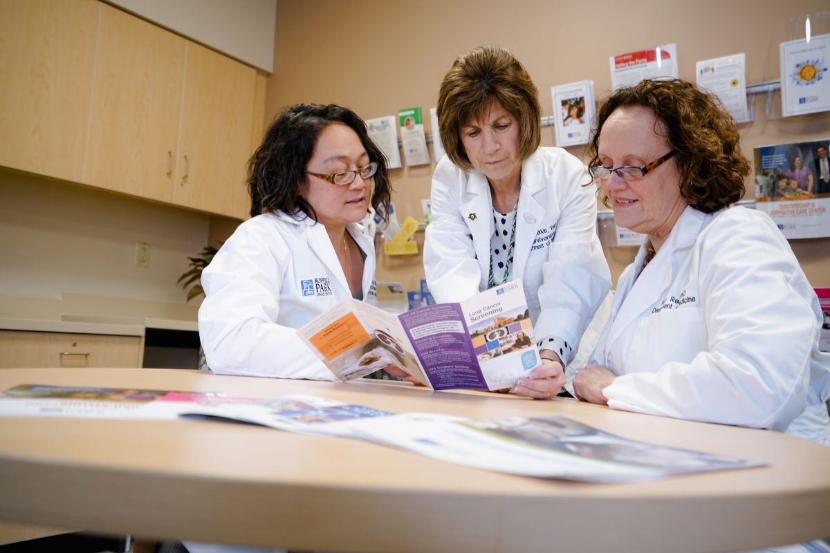 Three Roswell Park professionals review cancer screening publications.