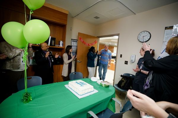 Patient Scott Bloomgren celebrates his 100th infusion treatment.