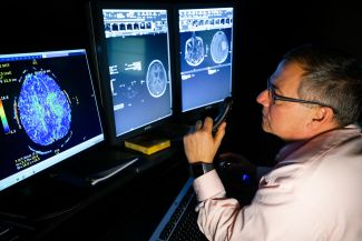 Dr. Ronald Alberico looking at a brain scan