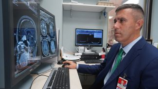Dr Fabiano looking at brain scans