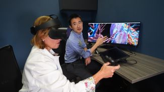 Dr. Larson Hsu shows Dr. Ermelinda Bonaccio how 3-D Imaging can be used to identify the size and shape of tumors.