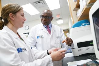 Two people at work in Roswell Park's Center for Immunotherapy