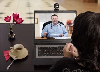 virtual doctor visit with woman