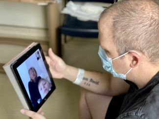 Patient video chatting with family on iPad